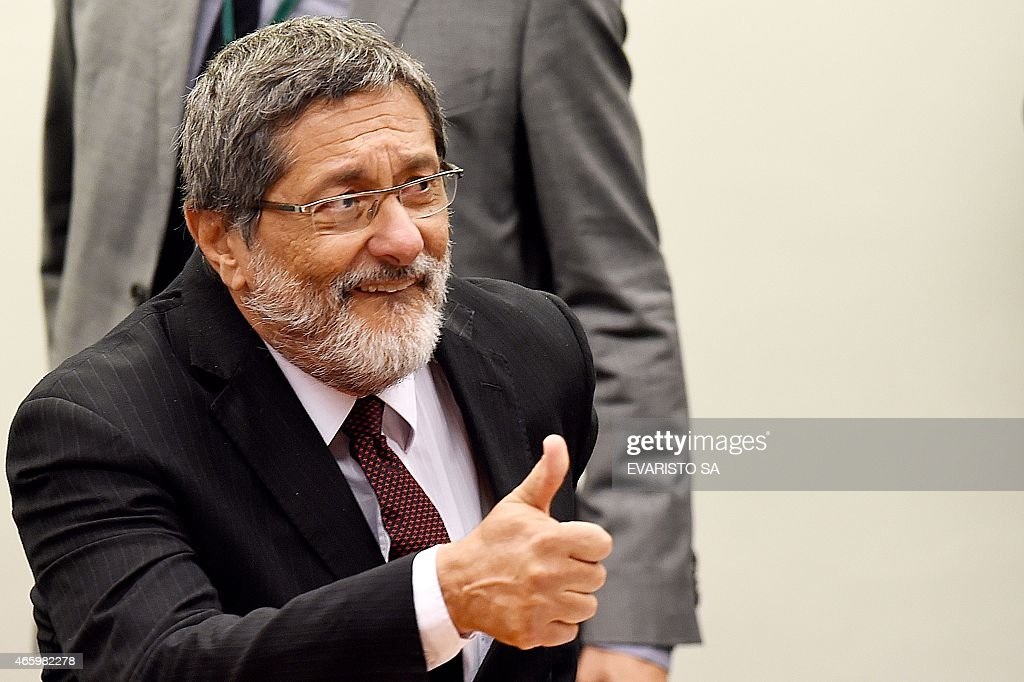 Petrobras former President Jose Sergio Gabrielli gives the thumbs up during a hearing with the Parliamentary Commission of Inquiry that investigates...
