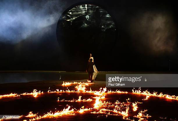 A petroglyph representing Da Vinci's Vitruvian Man burns during the Opening Ceremony for the Baku 2015 European Games at the Olympic Stadium on June...