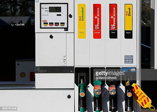 Petrol and diesel pumps are pictured outside a Royal Dutch Shell petrol station in Hook near Basingstoke on January 20 2016 Royal Dutch Shell said it...