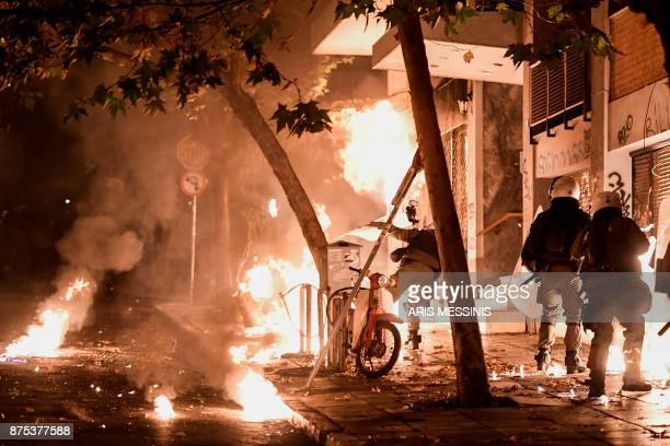 TOPSHOT A petrol bomb explodes next to antiriot policemen in downtown Athens on November 17 during clashes following a rally commemorating the 1973...
