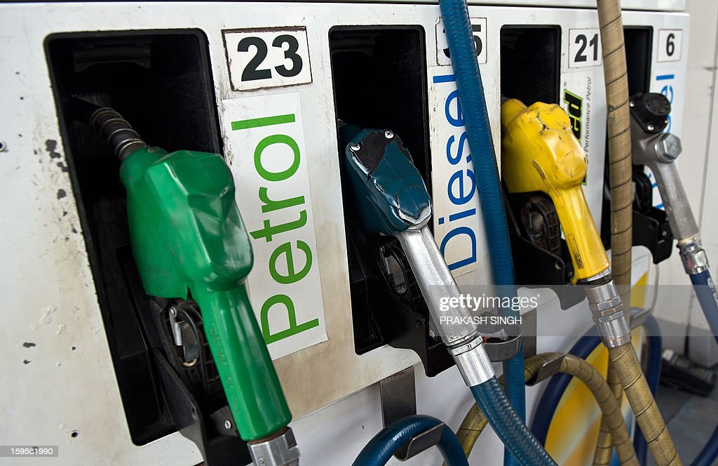 A petrol fuel pump is pictured at a station in New Delhi on January 16, 2013. Petrol price was hiked late January 15 night by about 35 paise per litre in line with firming raw material cost. Petrol will cost Rs 67.56 per litre in Delhi with effect from midnight, as the state government withdrew VAT exemption on the fuel. AFP PHOTO/ Prakash SINGH