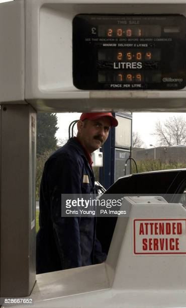 A petrol pump attendent fills the tank of a car near Saffron Walden in Essex Small Independent petrol stations are slowly disappearing in the face of...