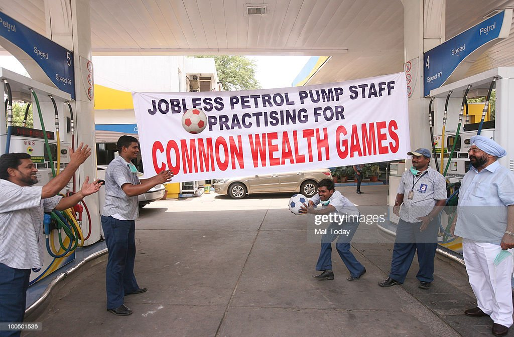 A petrol pump workers play games during petrol pump dealers' strike in New Delhi on May 24, 2010.