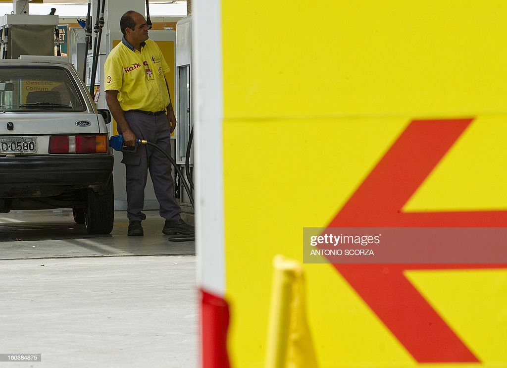 A petrol station worker prepares to refuel a car on January 30 , 2013 in Rio de Janeiro, Brazil. The price of the fuel in Brazil increased in 6,5% at the refinery, meaning 4,6% to the customers at the petrol pump.