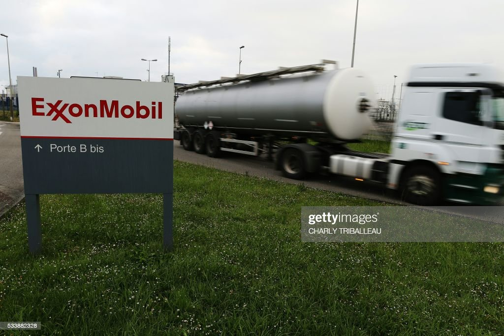 A petrol tanker leaves the ExxonMobil oil refinery in Notre-Dame-de-Gravenchon, northwestern France, on May 24, 2016, unionists had called for a strike following blockades of several oil refineries and fuel depots in France by protesters opposed to government labour reforms. The morning teams of the ExxonMobil oil refinery in Notre-Dame-de-Gravenchon, France's second largest refinery, seemed to ignore a strike called by the Force Ouvriere (FO) and General Confederation of Labour (CGT) French workers' unions on May 24. / AFP / CHARLY