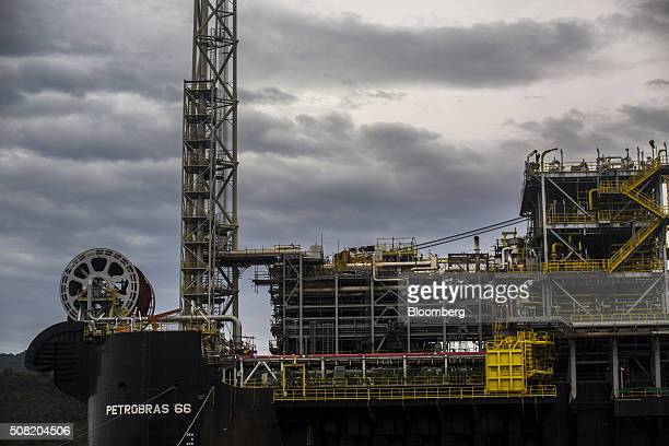 A Petroleo Brasileiro SA Floating Production Storage and Offloading vessel sits at a maintenance shipyard in Angra dos Reis Brazil on Friday Jan 29...