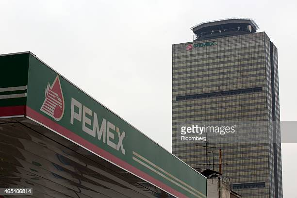 A Petroleos Mexicanos gas station lower left stands near the staterun oil company's headquarters building in Mexico City Mexico on Friday March 6...