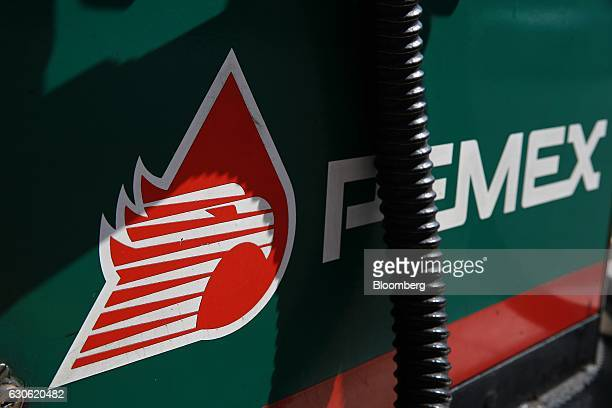 Petroleos Mexicanos signage is displayed on a fuel pump at the company's gas station in Mexico City Mexico on Wednesday Dec 28 2016 Mexico will raise...