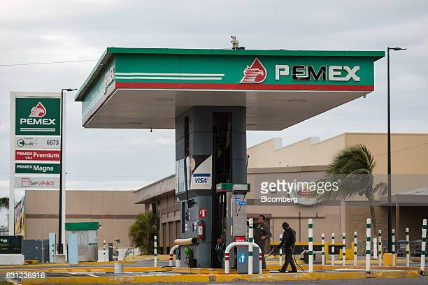 Petroleos Mexicanos workers clean the company's gas station following looting in Veracruz City Mexico on Sunday Jan 8 2017 Mexico's National...
