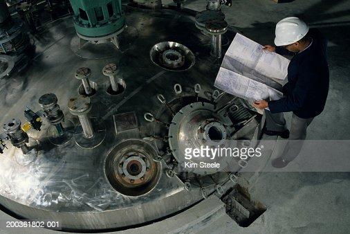 Petroleum Industry, Engineer at Reactor, elevated view