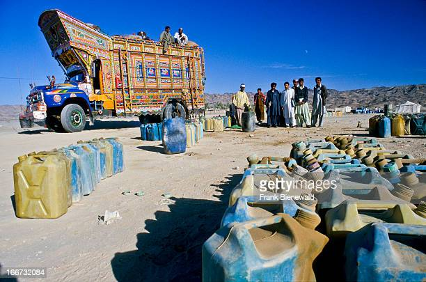 NOSHKI BELOUCHISTAN PAKISTAN Petrolstation selling smuggeled petrol from Iran to Truckdrivers in Pakistan