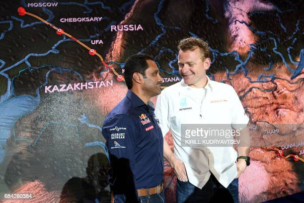 Petronas Iveco's Dutch driver Gerard De Rooy and Toyota's pilot Nasser AlAttiyah of Qatar attend the presentation of the 2017 Silk Way Rally in...
