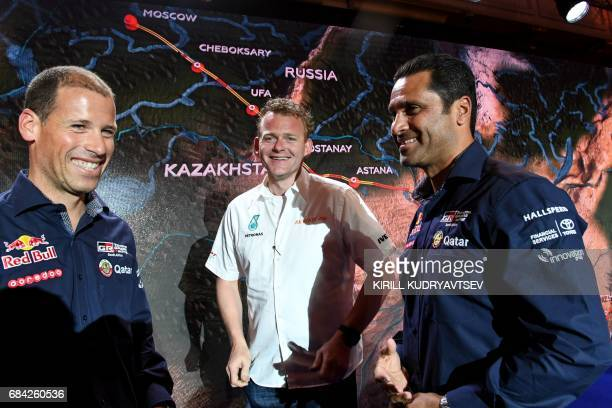 Petronas Iveco's Dutch driver Gerard De Rooy and Toyota's pilot Nasser AlAttiyah of Qatar and his copilot Mathieu Baumel of France attend the...
