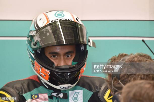 Petronas Raceline Malaysia Moto2 rider Hafizh Syahrin of Malaysia sits in his garage before the first practice session of the Australian MotoGP Grand...