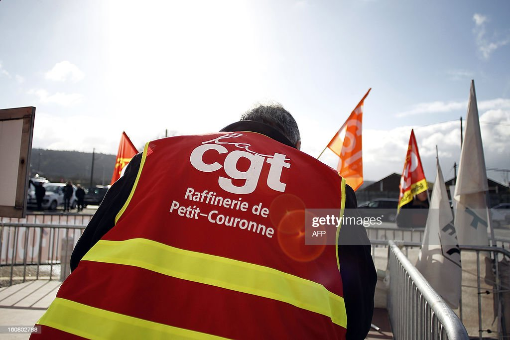A Petroplus worker is pictured during a protest outside the Petroplus oil refinery, on February 6, 2013 in Petit-Couronne, northwestern France. Petroplus bankrupt oil refinery northwest of Paris has attracted five offers, with the two most serious bids coming from Egypt and Switzerland, the French ministry of industrial regeneration said on February 5, as the Petroplus site that employs 470 people focused French anxiety over plant closures.
