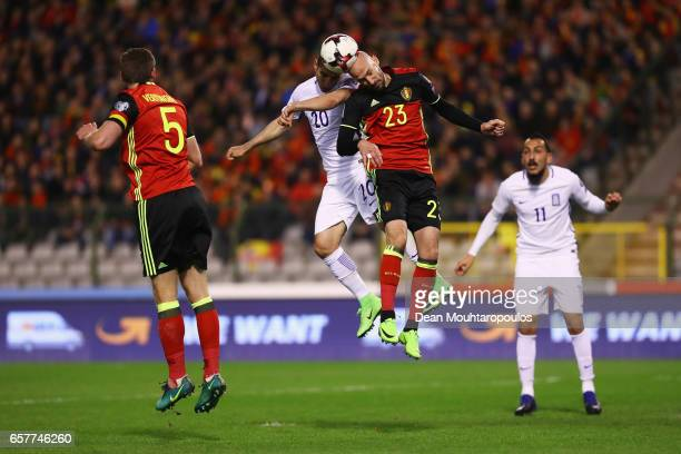 Petros Mantalos of Greece battles for the ball with Laurent Ciman of Belgium during the FIFA 2018 World Cup Group H Qualifier match between Belgium...