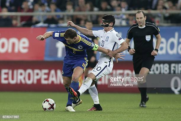 Petros Mantalos of Greece in action against Edin Dzeko of Bosnia and Herzegovina during the 2018 World Cup qualifying Group H football match between...