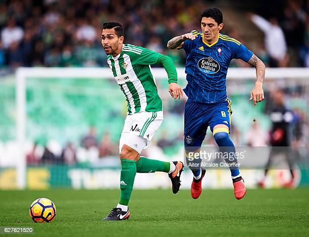 Petros Matheus dos Santos of Real Betis Balompie being followed by Pablo Hernandez of RC Celta de Vigo during La Liga match between Real Betis...