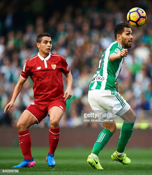 Petros Matheus dos Santos of Real Betis Balompie being followed by Wissam Ben Yedder of Sevilla FC during La Liga match between Real Betis Balompie...