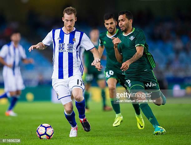 Petros Matheus dos Santos of Real Betis duels for the ball with David Zurutuza of Real Sociedad during the La Liga match between Real Sociedad de...