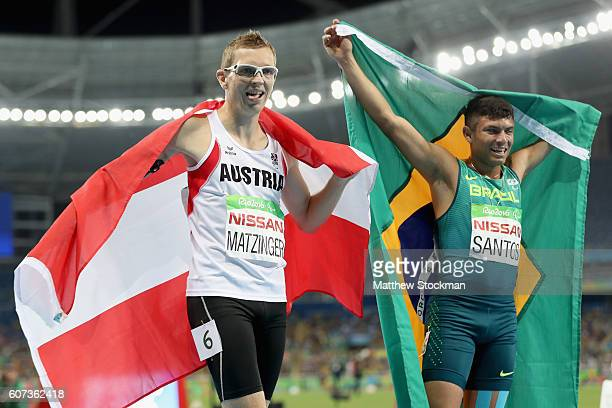 Petrucio Ferreira Dos Santos of Brazil and Gunther Matzinger of Austraia celebrate after completing the Men's 400m T47 Final during day 10 of the Rio...