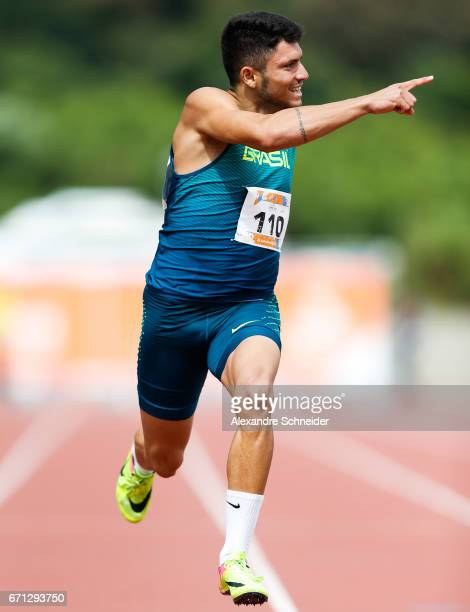 Petrucio Ferreira dos Santos of Brazil crosses the line to win the gold medal of the 100 meters mens finals at Brazilian Paralympic Training Center...