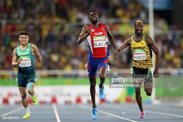 Petrucio Ferreira dos Santos of Brazil Ernesto Blanco of Cuba and Shane Hudson of Jamaica competes at the Men's 400m T47 Final during day 10 of the...
