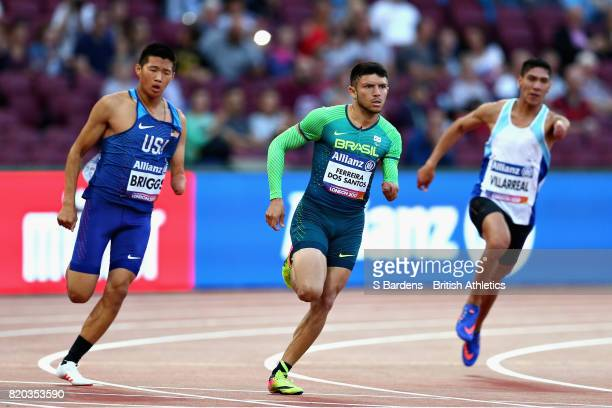 Petrucio Ferreira dos Santos of Brazil leads Braian Nahuel Villarreal of Argentina and Jack Briggs of USA in round one heat two of the Mens 200m T47...