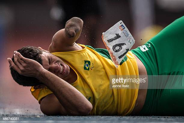 Petrucio Ferreira of Brazil falls and hurts himself during the Men's 200m T47 series during day two of the Open Caixa Loterias 2014 Paralympics...