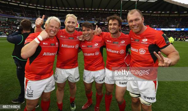 Petrus du Plessis Vincent Koch Schalk Brits Marcelo Bosch and Schalk Burger of Saracens celebrate victory during the European Rugby Champions Cup...