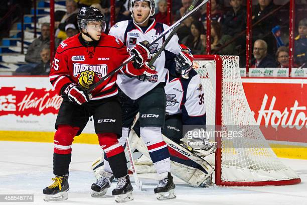 Petrus Palmu of the Owen Sound Attack battles out front against Trevor Murphy of the Windsor Spitfires on November 6 2014 at the WFCU Centre in...