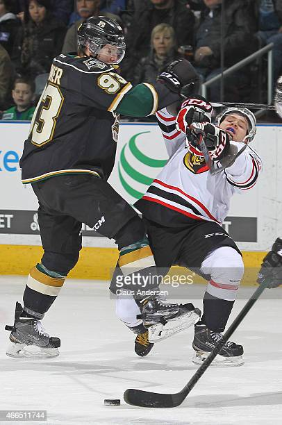 Petrus Palmu of the Owen Sound Attack is hammered by Mitchell Marner of the London Knights during an OHL game at Budweiser Gardens on March 13 2015...