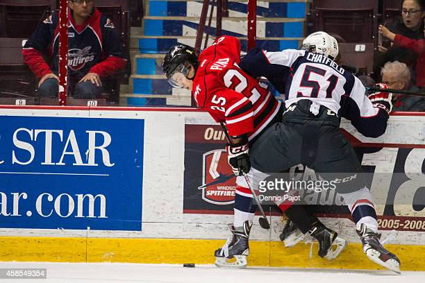 Petrus Palmu of the Owen Sound Attack moves the puck against Jalen Chatfield of the Windsor Spitfires on November 6 2014 at the WFCU Centre in...