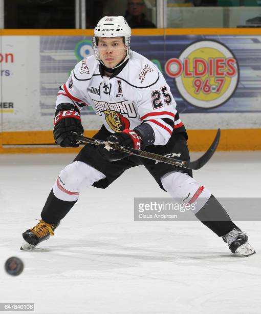 Petrus Palmu of the Owen Sound Attack watches a bouncing puck against the Peterborough Petes during an OHL game at the Peterborough Memorial Centre...