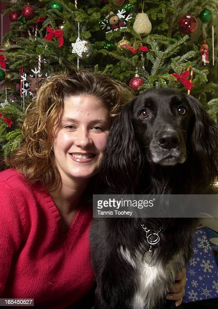 Dec212001Amanda Bresseau and her labrador Border collie cross Jazz pose at home infront of the Christmas treefor story on pets and their owners at...