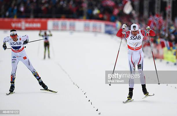Petter Jr Northug of Norway competes with Calle Halfvarsson of Sweden on the way to winning the gold medal in the Men's 4 x 10km CrossCountry Relay...