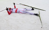 Petter Jr Northug of Norway lies in the snow after winning the gold medal in the Men's 50km Mass Start CrossCountry during the FIS Nordic World Ski...