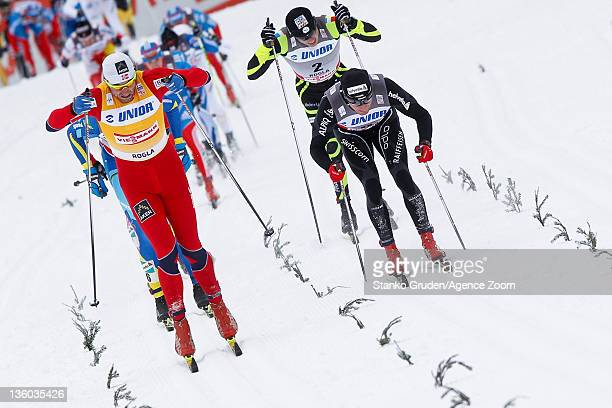 Petter jr Northug of Norway takes 1st place Dario Cologna of Switzerland takes 2nd place during the FIS Cross Country World Cup Men's 15km Mass Start...