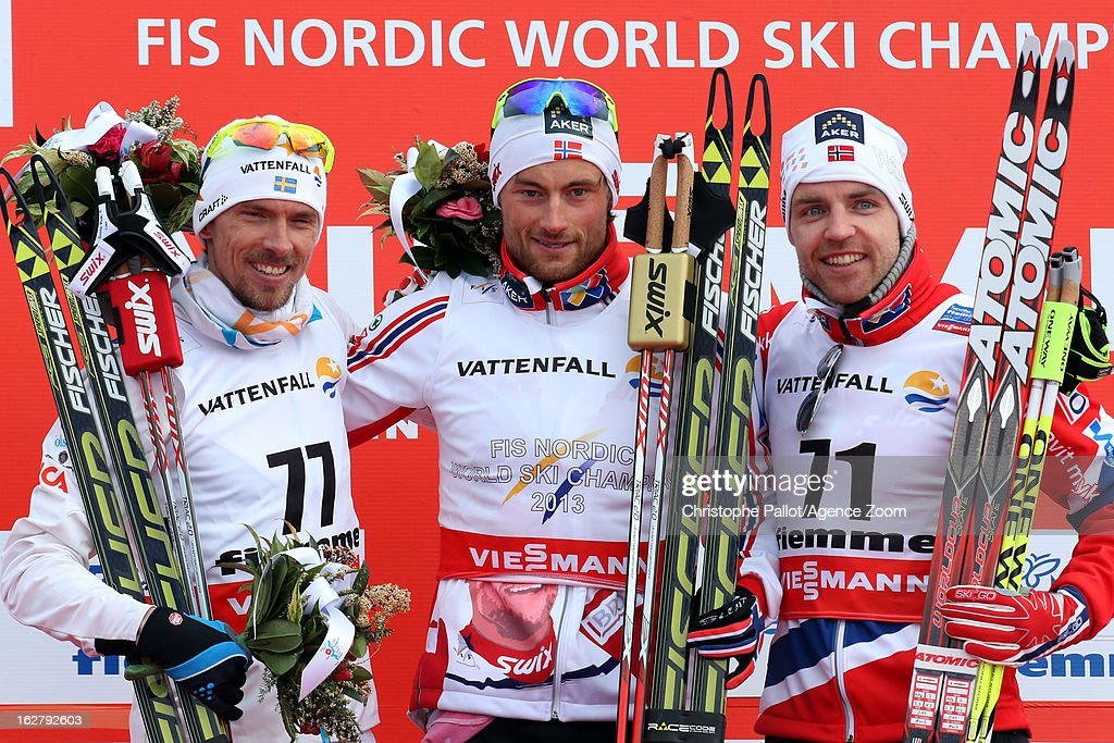 Petter jr. Northug of Norway takes the gold medal, <a gi-track='captionPersonalityLinkClicked' href=/galleries/search?phrase=Johan+Olsson&family=editorial&specificpeople=724246 ng-click='$event.stopPropagation()'>Johan Olsson</a> of Sweden takes the silver medal, Tord Aslme Gjerdalen of Norway takes the bronze medal competes during the FIS Nordic World Ski Championships Cross Country Men's Distance on February 27, 2013 in Val di Fiemme, Italy.