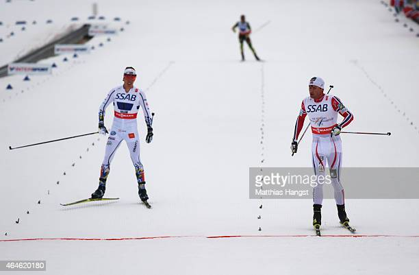 Petter Jr Northug of Norway wins the gold medal from silver medallist Calle Halfvarsson of Sweden during the Men's 4 x 10km CrossCountry Relay during...