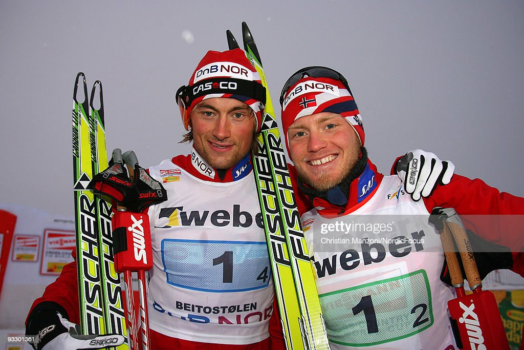 <a gi-track='captionPersonalityLinkClicked' href=/galleries/search?phrase=Petter+Northug&family=editorial&specificpeople=800847 ng-click='$event.stopPropagation()'>Petter Northug</a> (L) and Martin Johnsrud Sundby of Team Norway finish first in the Men's 4x5km Cross Country Relay during day two of the FIS World Cup on November 22, 2009 in Beitostoelen, Norway.