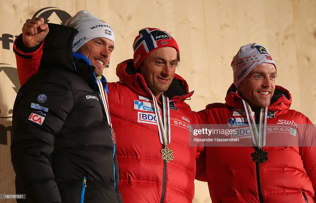 Petter Northug Jr. of Norway celebrates his Gold medal with Silver medalist <a gi-track='captionPersonalityLinkClicked' href=/galleries/search?phrase=Johan+Olsson&family=editorial&specificpeople=724246 ng-click='$event.stopPropagation()'>Johan Olsson</a> of Sweden (l) and Bronze medalist <a gi-track='captionPersonalityLinkClicked' href=/galleries/search?phrase=Tord+Asle+Gjerdalen&family=editorial&specificpeople=2093175 ng-click='$event.stopPropagation()'>Tord Asle Gjerdalen</a> of Norway (r) at the medal ceremony for the Men's Cross Country Individual 15km at the FIS Nordic World Ski Championships on February 27, 2013 in Val di Fiemme, Italy.
