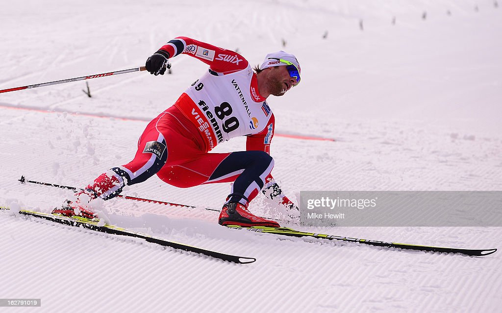 Petter Northug Jr. of Norway crosses the line to claim victory in the Men's Cross Country Individual 15km at the FIS Nordic World Ski Championships on February 27, 2013 in Val di Fiemme, Italy.