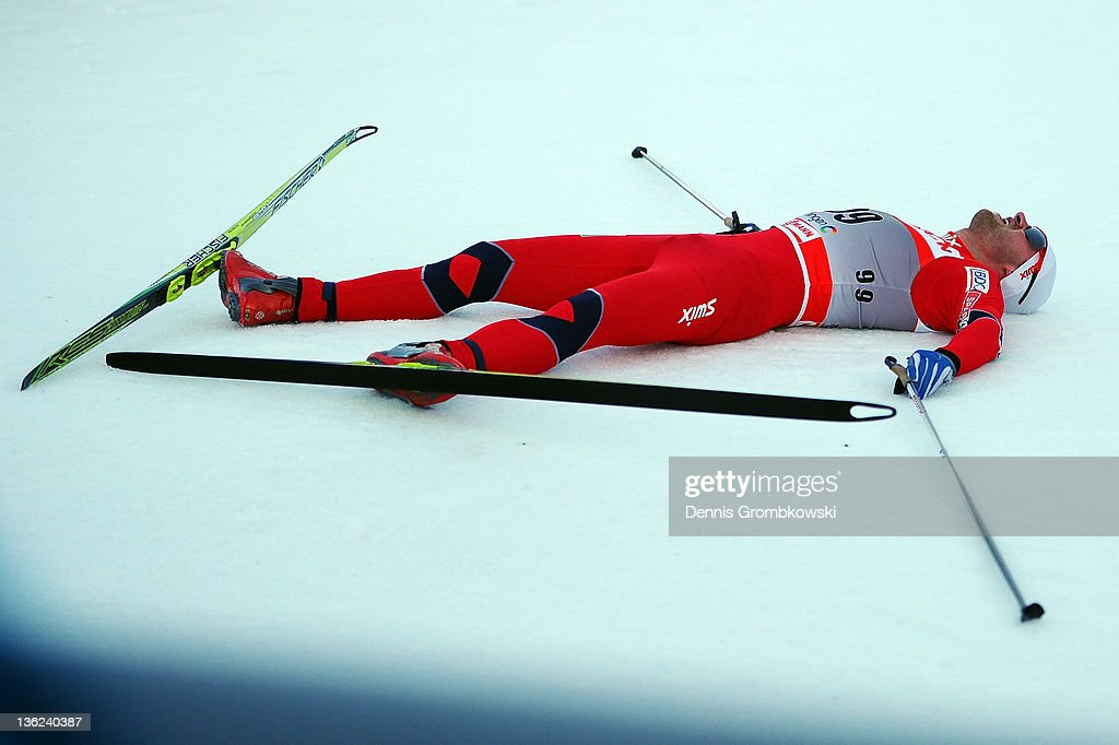 <a gi-track='captionPersonalityLinkClicked' href=/galleries/search?phrase=Petter+Northug&family=editorial&specificpeople=800847 ng-click='$event.stopPropagation()'>Petter Northug</a> Jr. of Norway lies on the ground after the FIS Tour de Ski Oberhof Men's Prolouge at DKB Ski Arena on December 29, 2011 in Oberhof, Germany.
