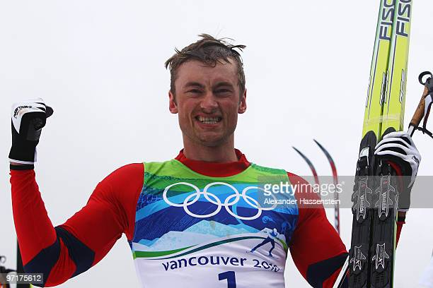 Petter Northug of Norway celebrates winning the gold medal during the Men's 50 km Mass Start Classic crosscountry skiing on day 17 of the 2010...