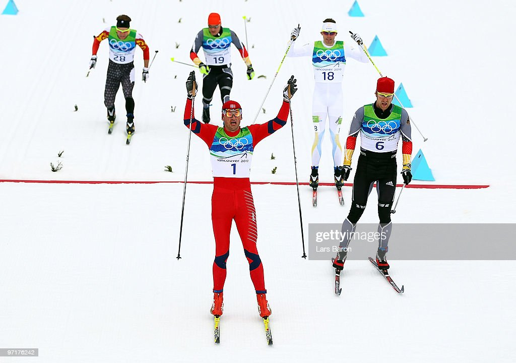 <a gi-track='captionPersonalityLinkClicked' href=/galleries/search?phrase=Petter+Northug&family=editorial&specificpeople=800847 ng-click='$event.stopPropagation()'>Petter Northug</a> #1 of Norway celebrates winning the gold medal from <a gi-track='captionPersonalityLinkClicked' href=/galleries/search?phrase=Axel+Teichmann&family=editorial&specificpeople=773876 ng-click='$event.stopPropagation()'>Axel Teichmann</a> (R) of Germany during the Men's 50 km Mass Start Classic cross-country skiing on day 17 of the 2010 Vancouver Winter Olympics at Whistler Olympic Park Cross-Country Stadium on February 28, 2010 in Whistler, Canada.