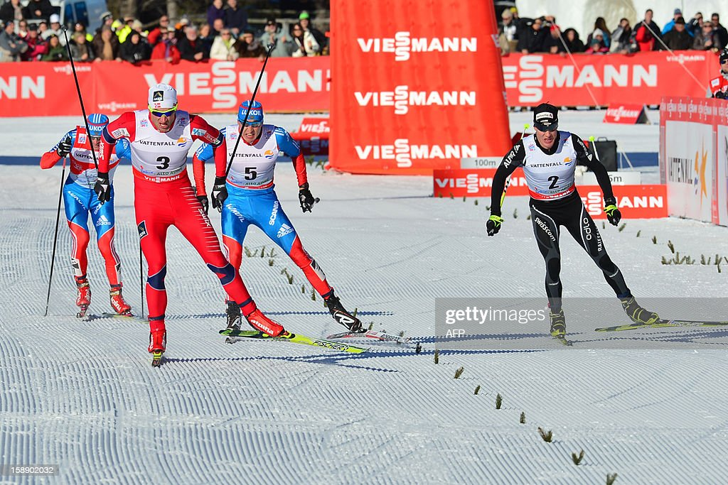 Petter Northug of Norway (2L) competes to win next to (L-R) Alexander Legkov of Russia, Dario Cologna of Swiss and Maxim Vylegzhanin of Russia (L) during the Cortina D'Ampezzo - Toblach 35 km free pursuit of the fourth stage of the men's Nordic Skiing Tour de Ski in Toblach on January 3, 2013. Norway's Petter Northug won ahead of Alexander Legkov of Russia and Dario Cologna of Swiss.