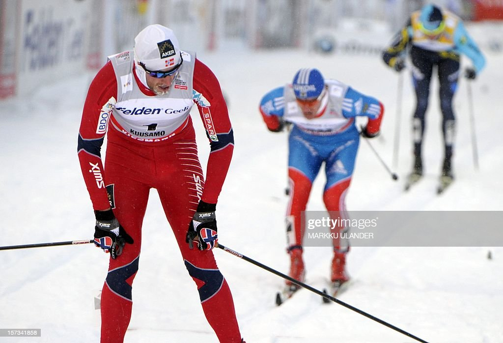 Petter Northug (L) of Norway competes to win the men 15km cross country pursuit classic style skiing competition of the FIS World Cup in Kuusamo, Finland on December 2, 2012. Maxim Vylegzhanin (C) of Russia placed second, Kazakhstan's Alexey Poltoranin (R) finished third.