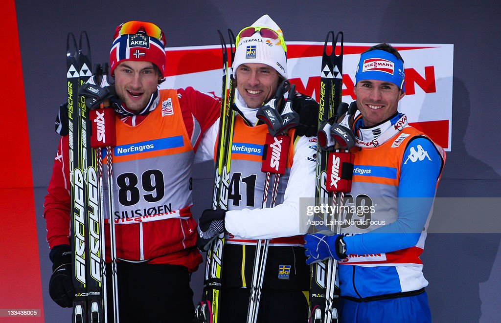 <a gi-track='captionPersonalityLinkClicked' href=/galleries/search?phrase=Petter+Northug&family=editorial&specificpeople=800847 ng-click='$event.stopPropagation()'>Petter Northug</a> of Norway, <a gi-track='captionPersonalityLinkClicked' href=/galleries/search?phrase=Johan+Olsson&family=editorial&specificpeople=724246 ng-click='$event.stopPropagation()'>Johan Olsson</a> of Sweden and <a gi-track='captionPersonalityLinkClicked' href=/galleries/search?phrase=Roland+Clara&family=editorial&specificpeople=4046950 ng-click='$event.stopPropagation()'>Roland Clara</a> of Italy pose on the podium after the mens individual 15km free technic Cross Country Skiing during the FIS World Cup on November 19, 2011, in Sjusjoen, Norway.
