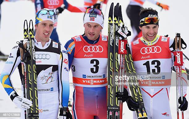 Petter Northug of Norway poses with second placed Alex Harvey of Canada and third placed Calle Halfvarsson of Sweden afte the Men's 15 km Pursuit...